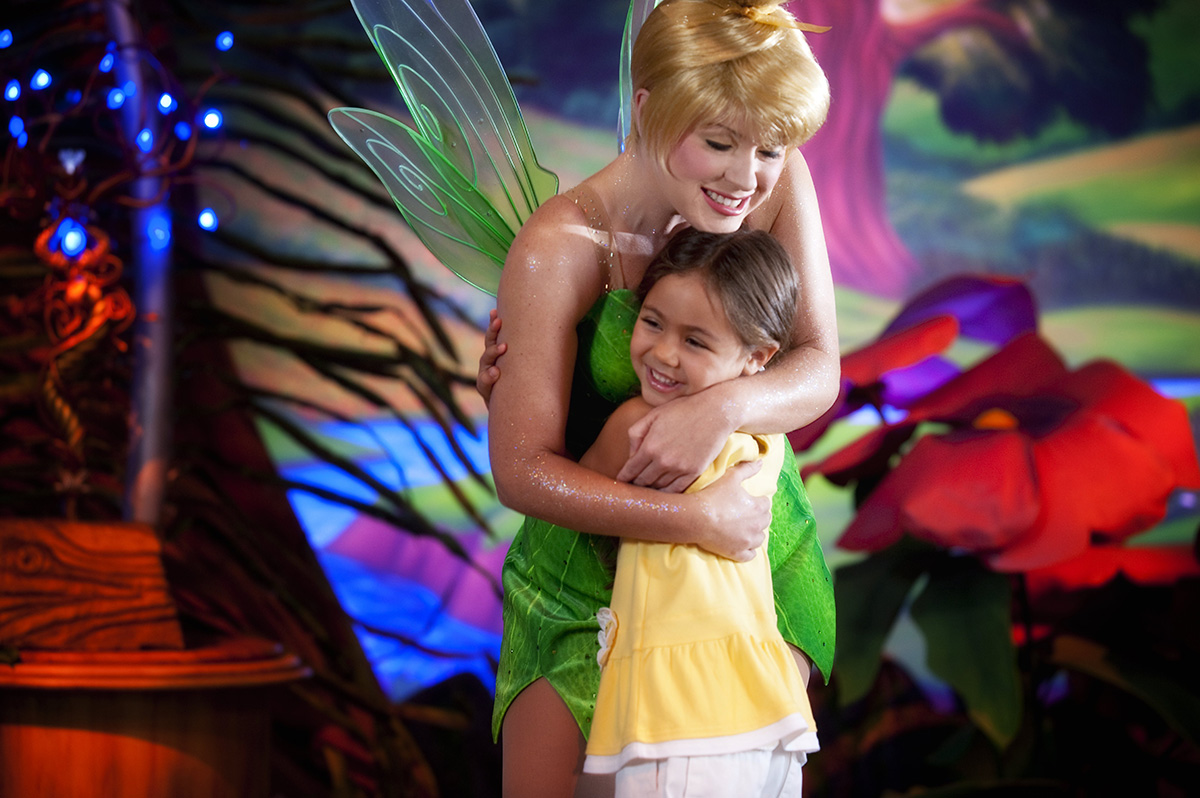 Young Guest Hugging Tinker Bell