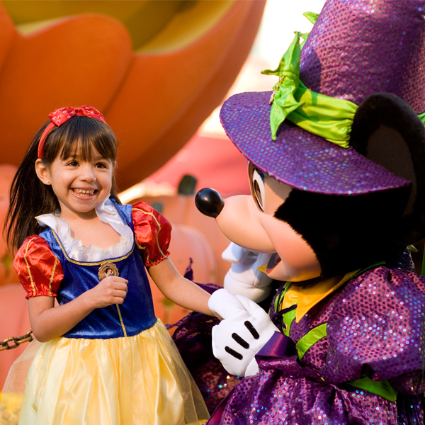 A little girl enjoys Mickey's Not-So-Scary Halloween Party.